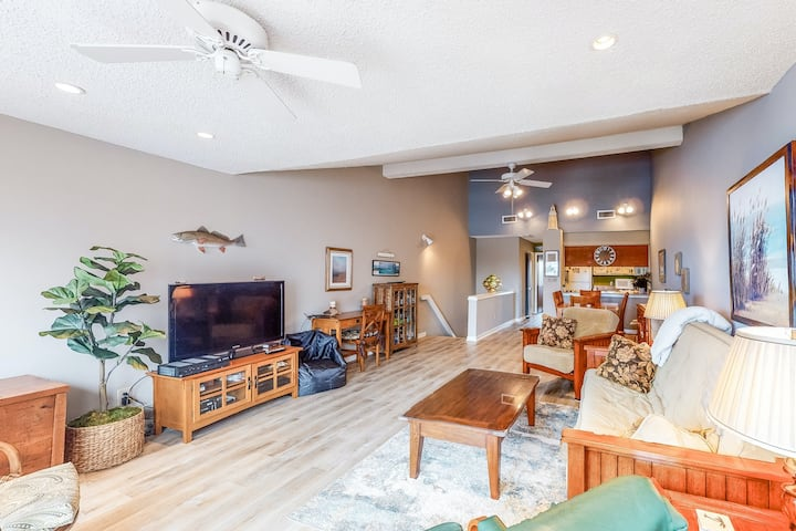 Dog-friendly waterfront home with central AC, deck, fenced-in yard, and dock!