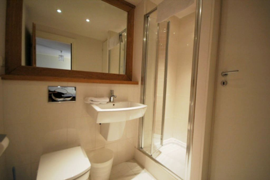 Modern bathroom with shower, basin & WC