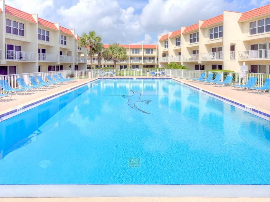 Lounge by the pool or jump in--the water's fine! - Keep an eye on the Atlantic ocean as you swim in the oceanfront pool. This is