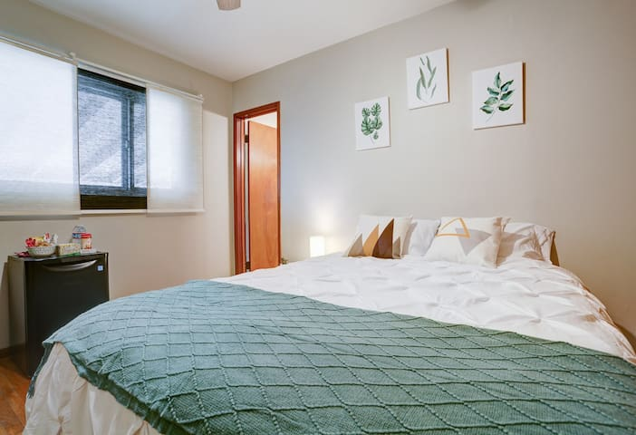 Master Bedroom with a comfy Queen bed & storage!