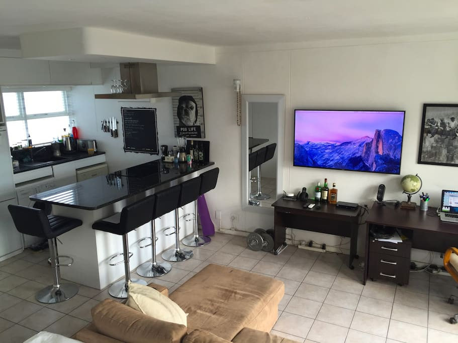 kitchen bar and large tv, viewable from bed