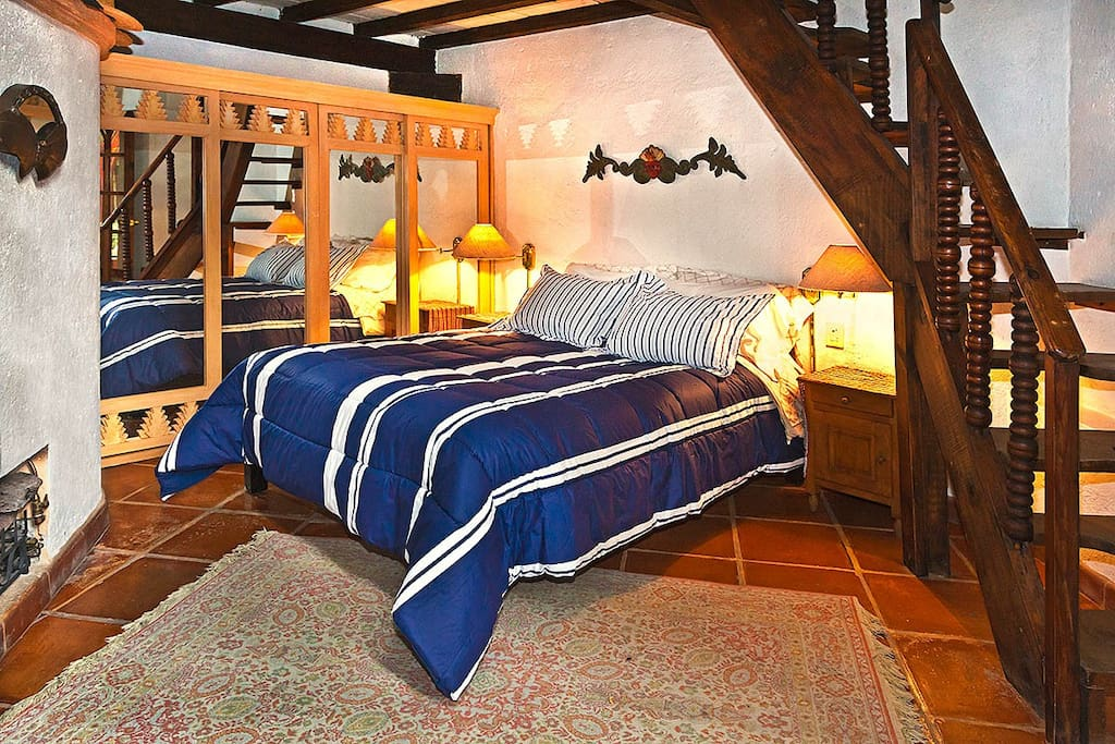 Bedroom with stairs leading to the loft