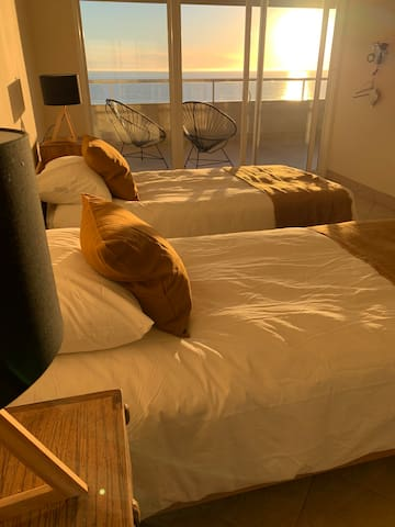 The guest bedroom has two very comfortable full sized beds with amazing ocean views.