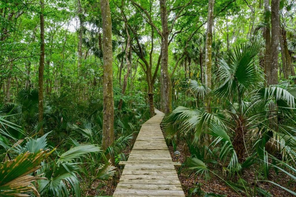Long boardwalk from the pool deck to the Tomoka River.