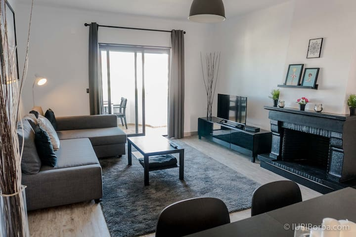 Comfy and large living, with flat screen TV dining area,  AC and a sofa bed to fit all the family, the cherry on the top is the access to the  balcony with a large area and a table and chairs for out door meals allowing a nice sunset view .
