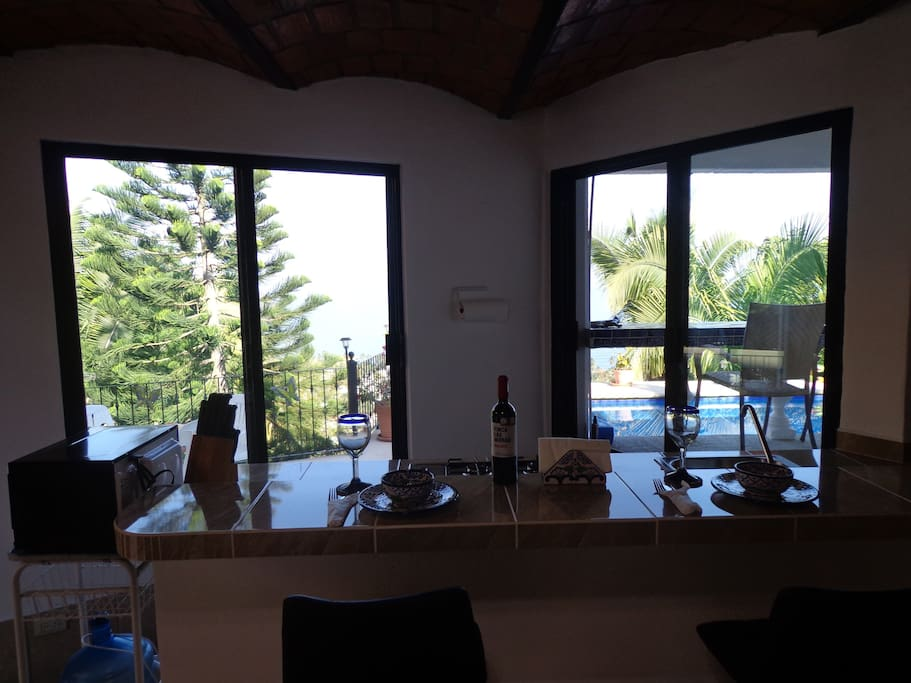 bar/kitchen has pass through window to outside bar balcony