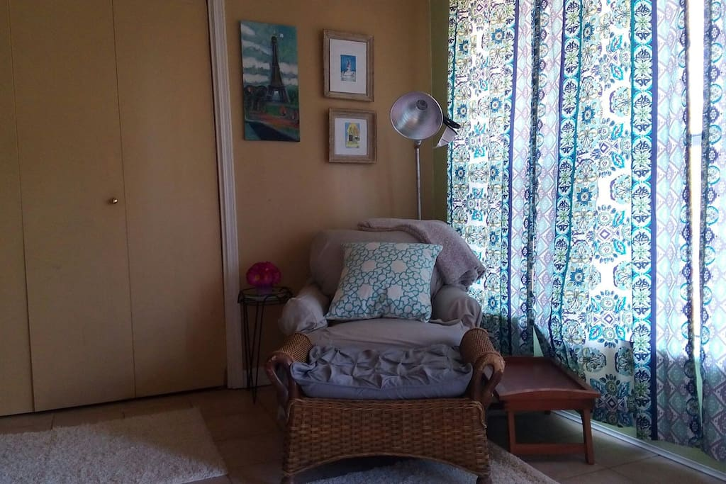 Great place to sit and relax in a comfy overstuffed chair and ottoman. New drapes on large private window.