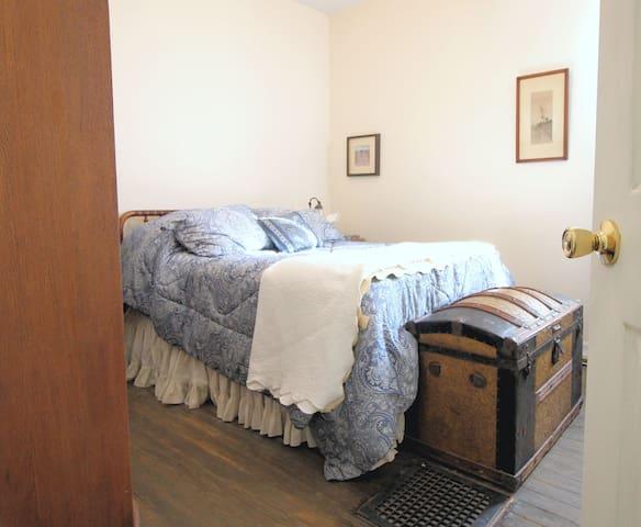 Bedroom with queen-size bed and lockable door.
