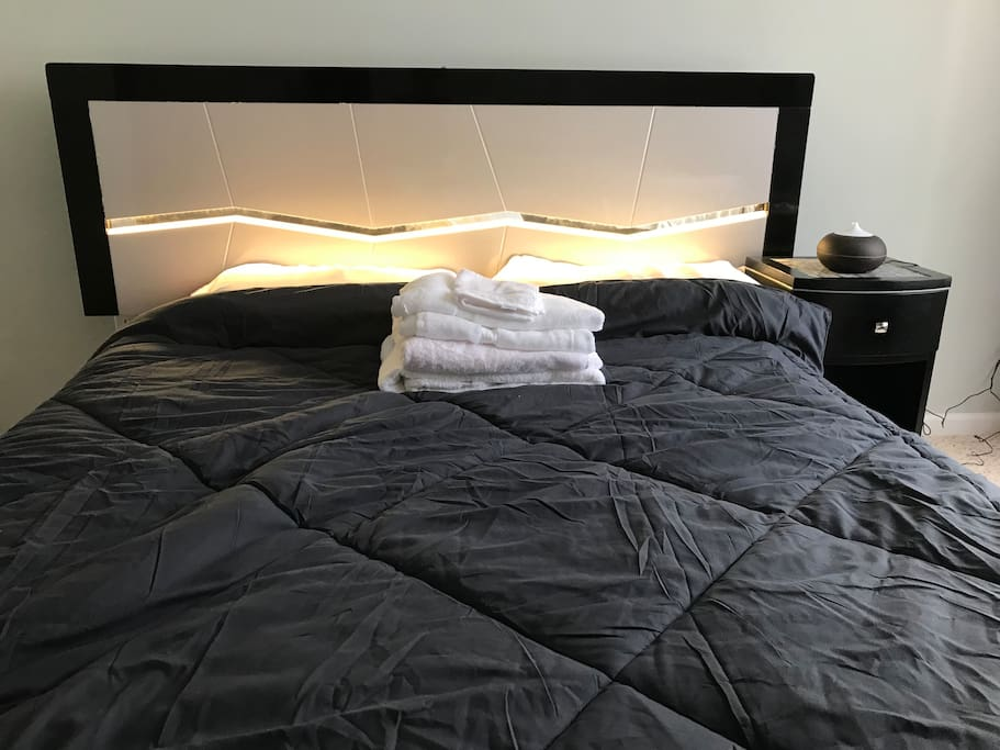 The headboard has a switch in the middle of the top that allows the bed light up as a bright light. Is substituted for a lamp as it's more convenient for guests.