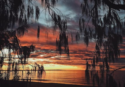 Watch the sunset on the beach.