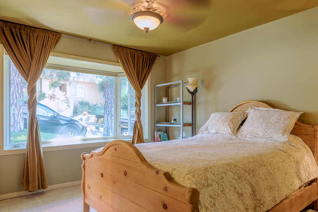 Spacious bedroom with a comfortable bed, and an armoire to store all your clothes in. The room is very sunny and bright because of the beautiful bay window, and when you want to sleep in, there are blackout curtains so you can get a good nights sleep