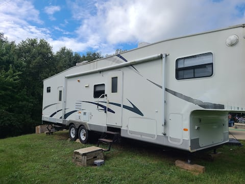camper with 2 bedrooms and kitchen with living room dining area in a pop out addition.  Located on Dragonfly Ranch by mammoth cave