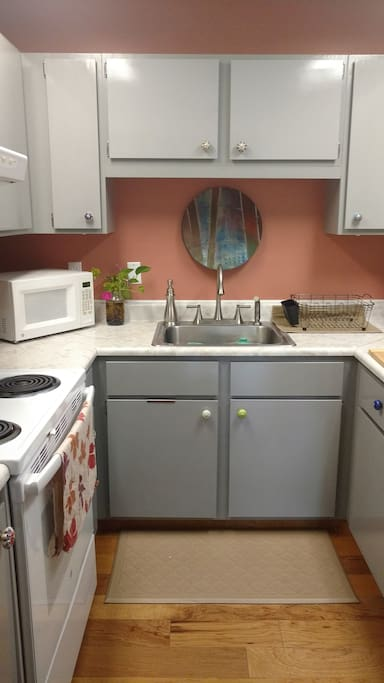 Kitchen: just freshened the walls up with a beautiful new color, hand made ceramic platter over the sink and plenty of well stocked cabinets!