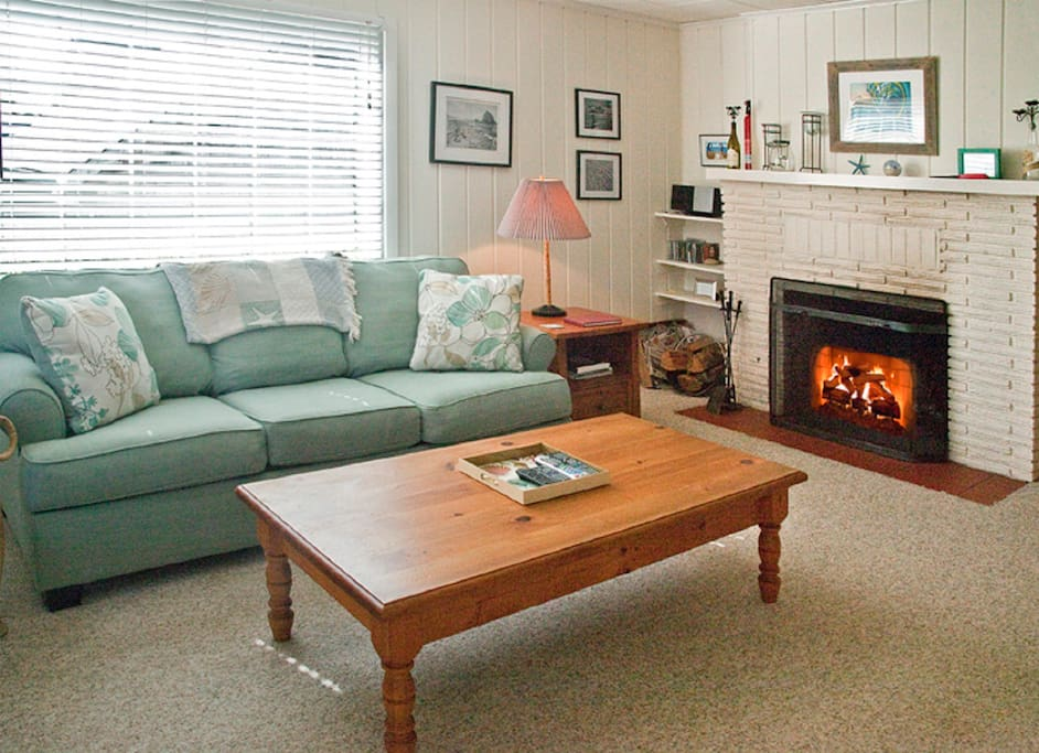 Cozy living room with wood burning fireplace (wood provided)