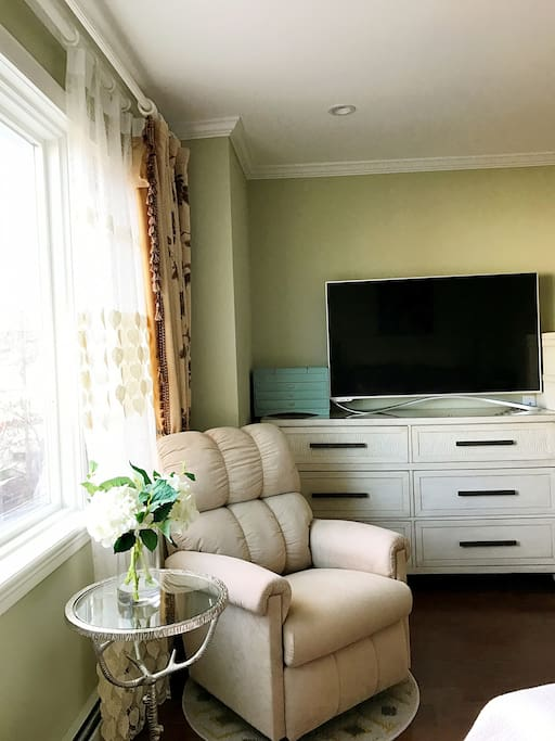 This is your wonderful room with a Smart TV, orthopedic high quality memory mattress, rocking chair and beautiful panorama window
