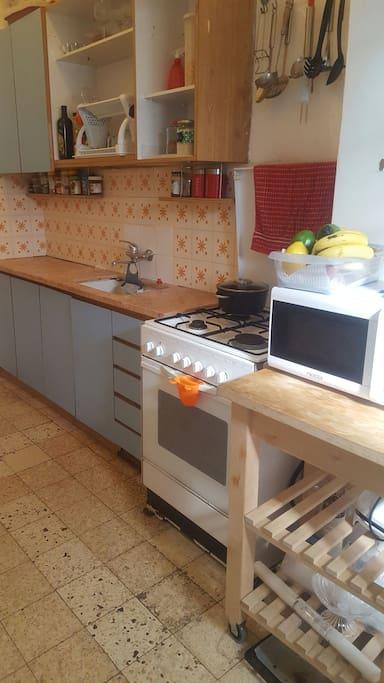 Accessorized kitchen, washing machine.