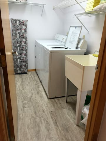 Upstairs laundry room with washer/dryer/laundry tub