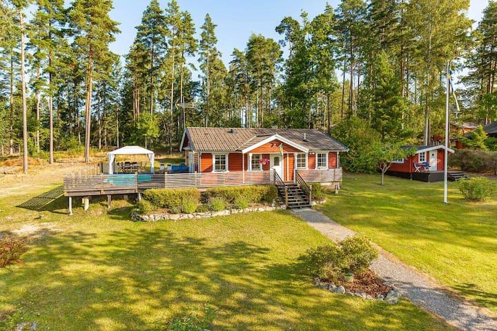 Traditional swedish house on an island. Pool