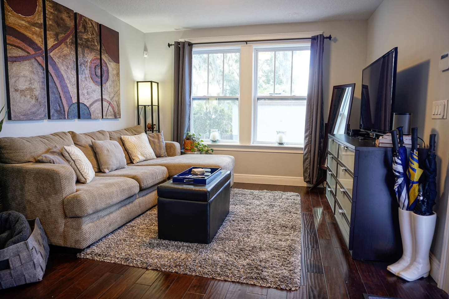 Comfy couch easily sleeps an extra guest. The apartment has downtown views with all the amenities needed!