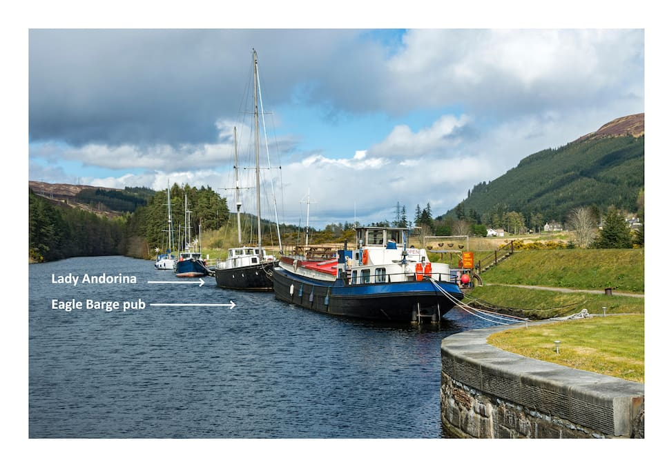 Lady Andorina is moored next to the Eagle Barge Inn on the Great Glen Way