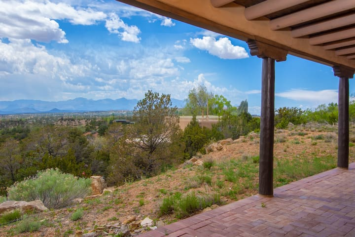 Enjoy breathtaking mountain views from the covered patio.