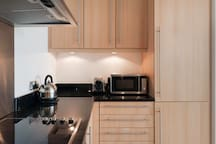 Fully stocked modern kitchen includes washer dryer, dishwasher, fridge/freezer, oven, microwave oven, etc