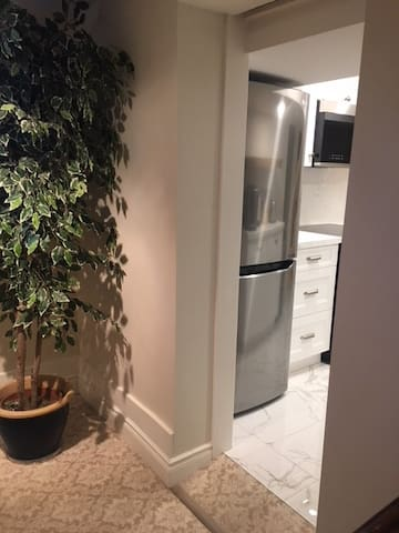 Entrance from living room to kitchen within apartment