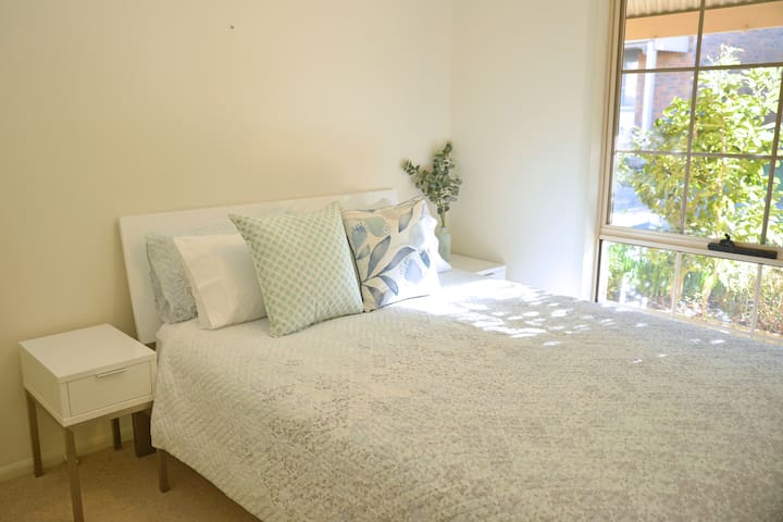 queen bed with soft linen