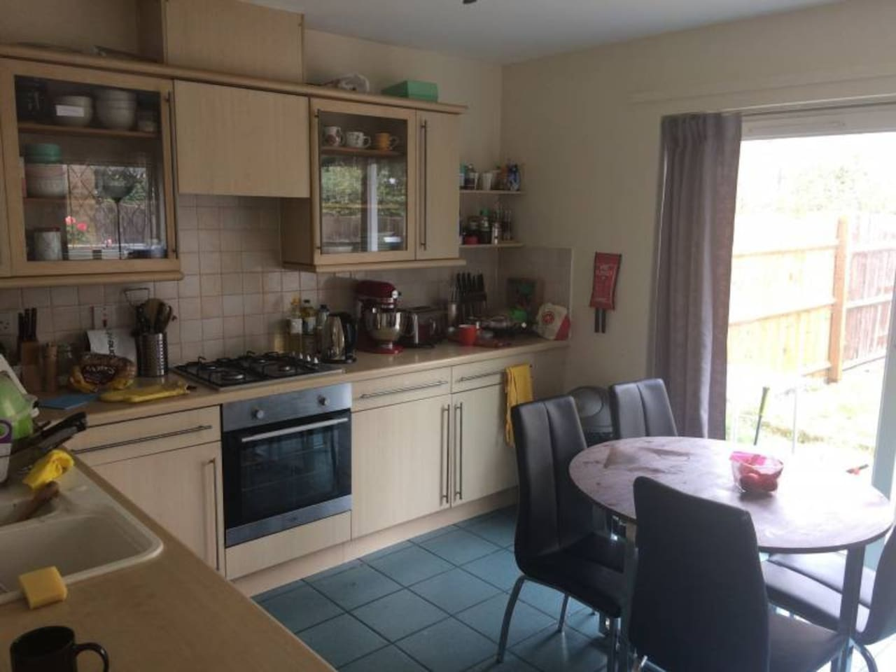 Kitchen with dining table, sofa, dishwasher