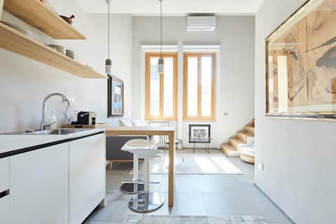Edelsteen van een loftruimte met terras aan de Arno