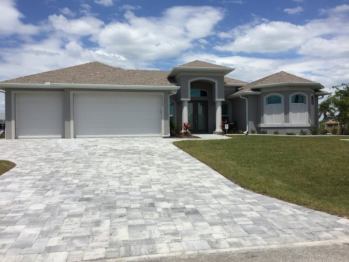 Water-front Home with 2 master suites, heated pool