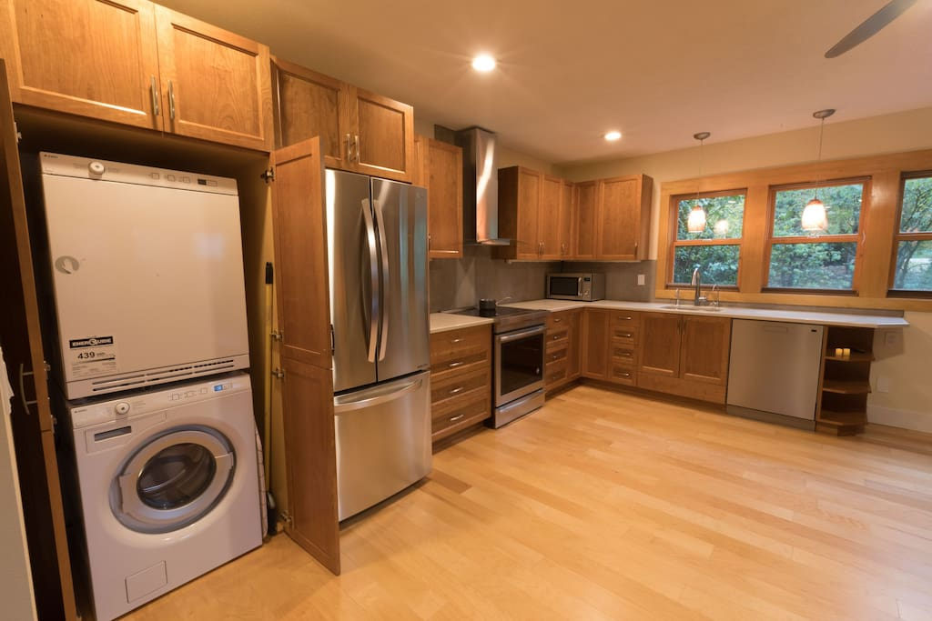 State of the art kitchen including stacked washer/dryer