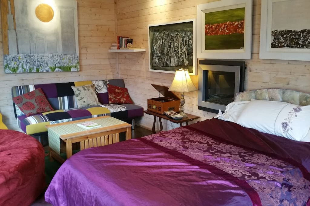 Interior of Cosy Chalet with sofa bed and BuddhaBag and Two Fires