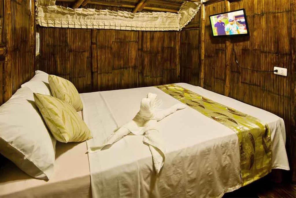 One of the 2 duplex bamboo hut bedrooms with queen size bed