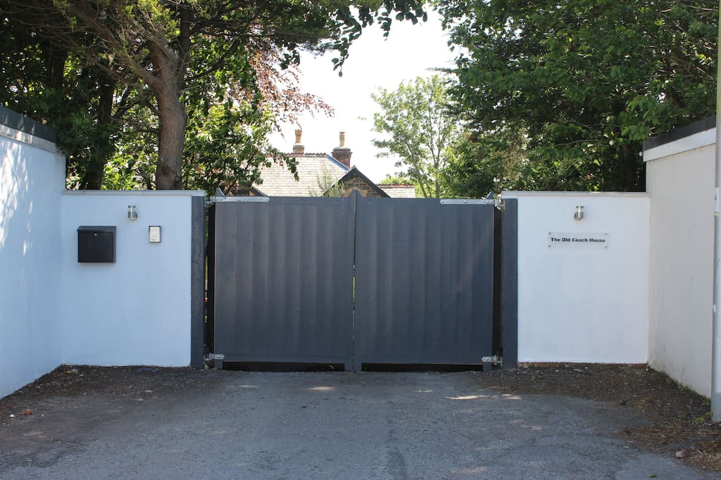 Main entrance with secure electric gates.