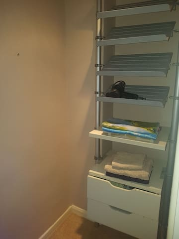An en-suite storage room for your essentials, also includes a double wardrobe. Includes holiday basics such as beach towels, hair dryer and iron / ironing board.
