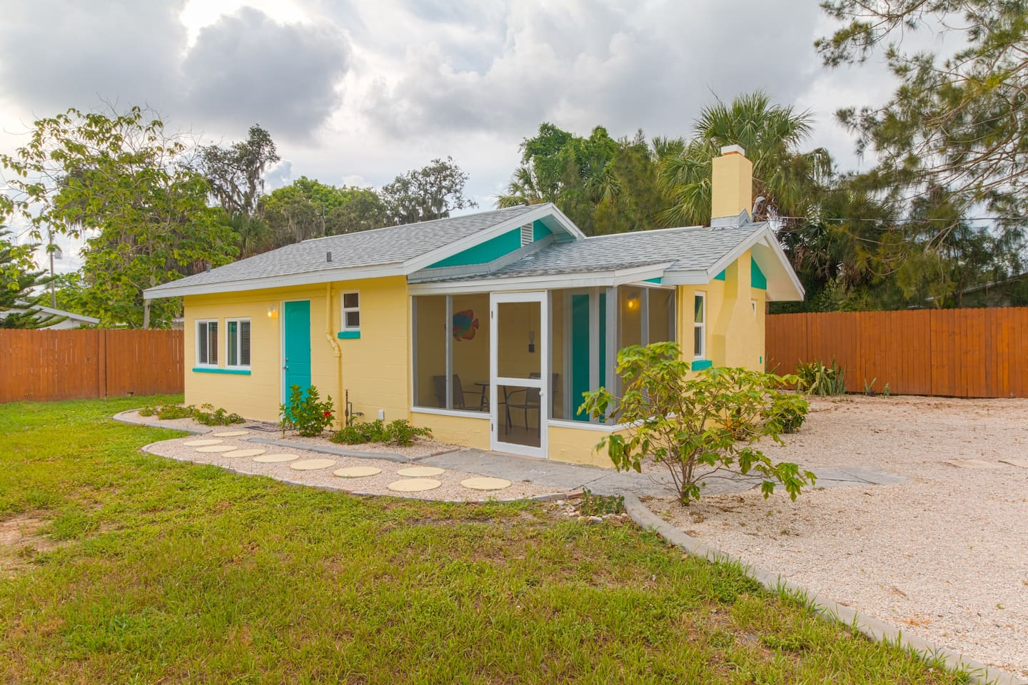 Standalone cottage is set back off the street in quiet neighborhood.