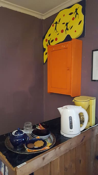 Room1. Is equipped with electric kettle and a coffee maker.