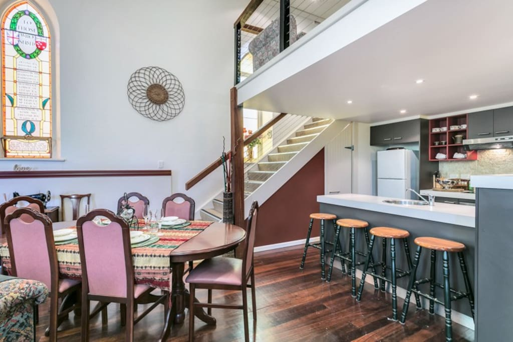 DINING - the table & chairs & casual coffee stools offers formal & informal eating spots & the under-stair cupboard stores an iron & ironing board, clothes airer, portable cot & high chair & first-aid items.