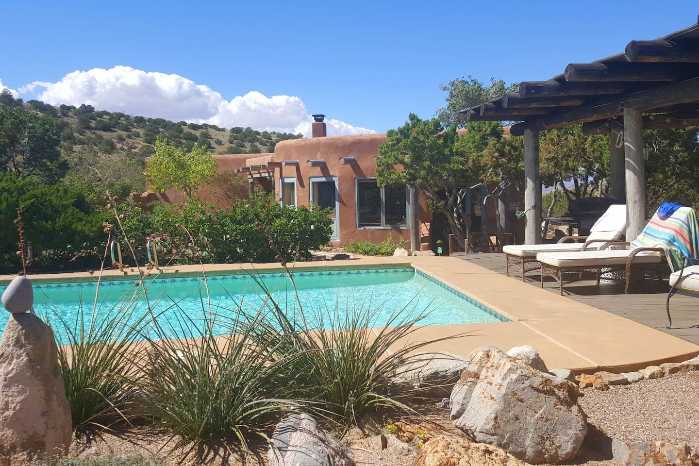 View of pool and high desert landscaping