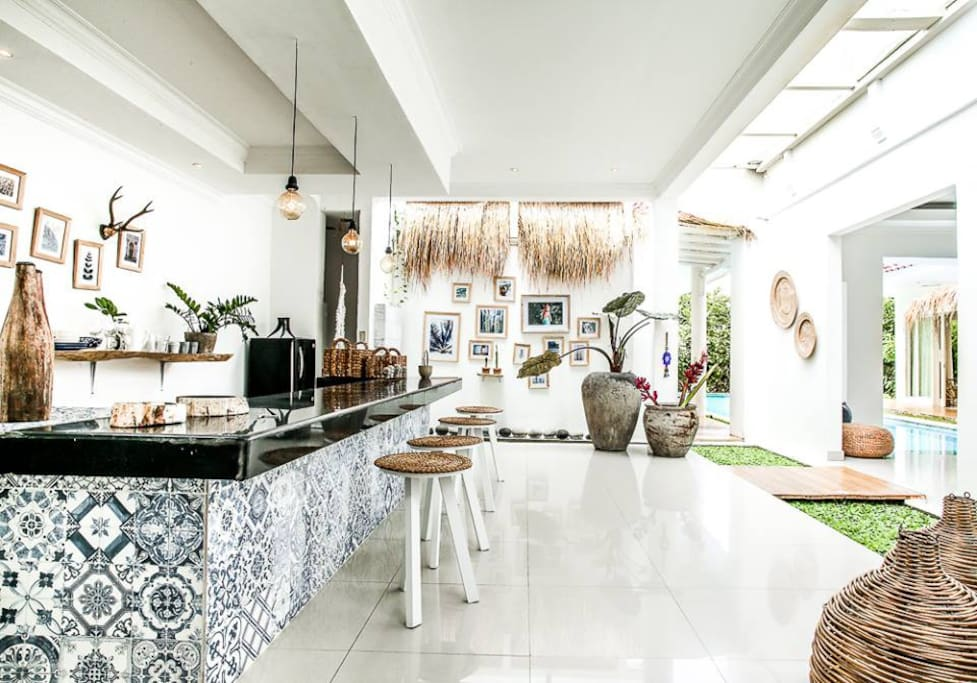 Amazing Kitchen wrapped around a pond with Jergen Teller prints and antique art