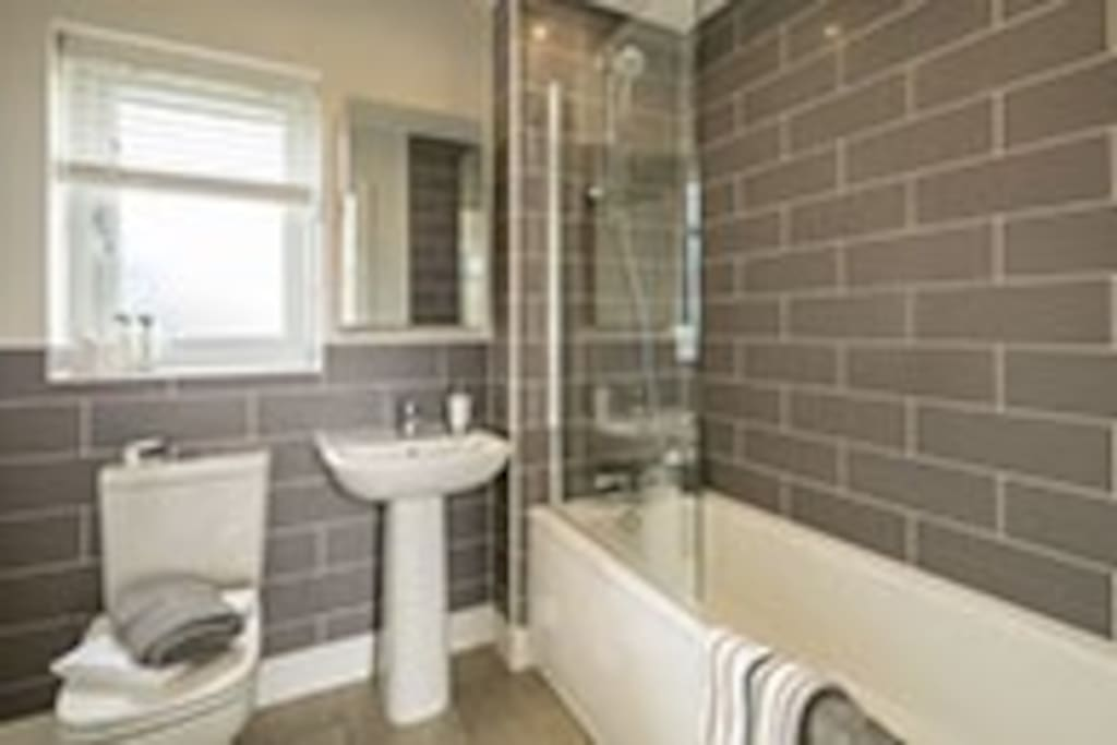Bath and shower facilities available with complimentary toiletries.