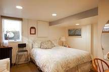 Here is another view of the queen bed.  There is a maple end table on one side of the bed.