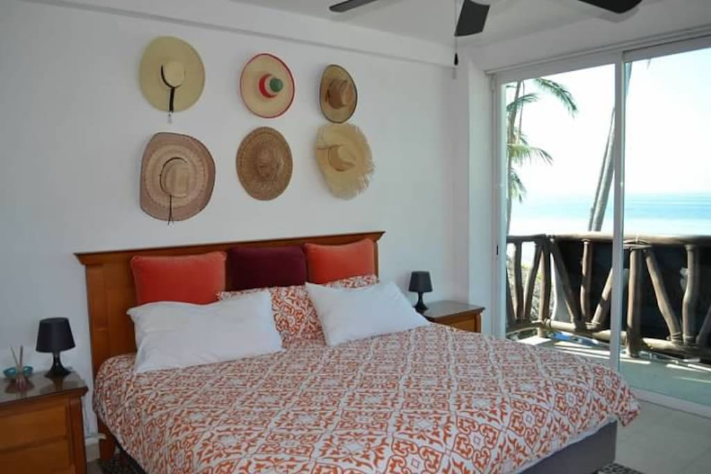 Private master-bedroom with balcony overlooking ocean