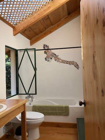 A mosaic of a quetzal adorns the guest bathroom wall