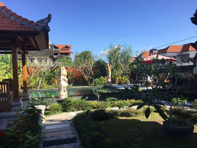 The pool and garden at Pondok Dewa