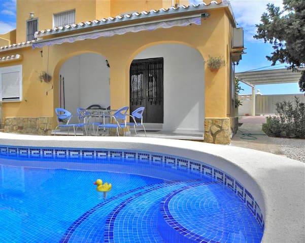 Villa with secluded garden & pool near beach