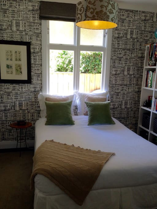 Comfortable furnished, warm and modern bedroom for two guests.