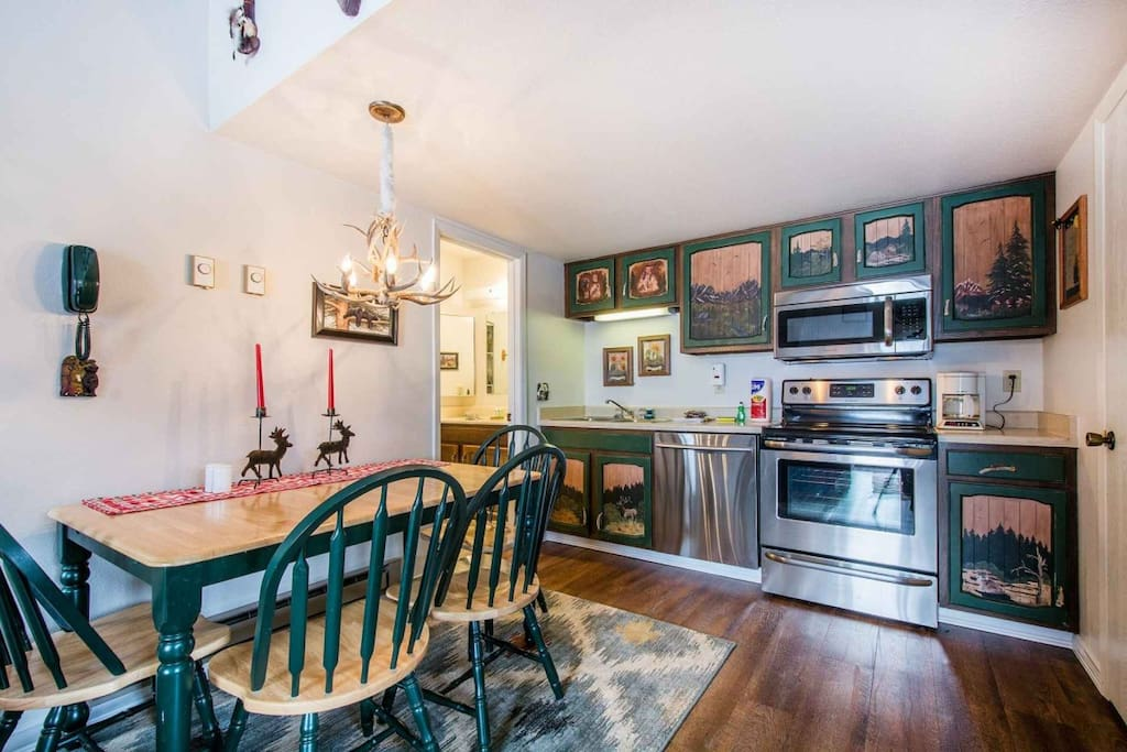 This kitchen has been completed updated with new household appliances that are all stainless steel - dishwasher, fridge, oven, stove, microwave.