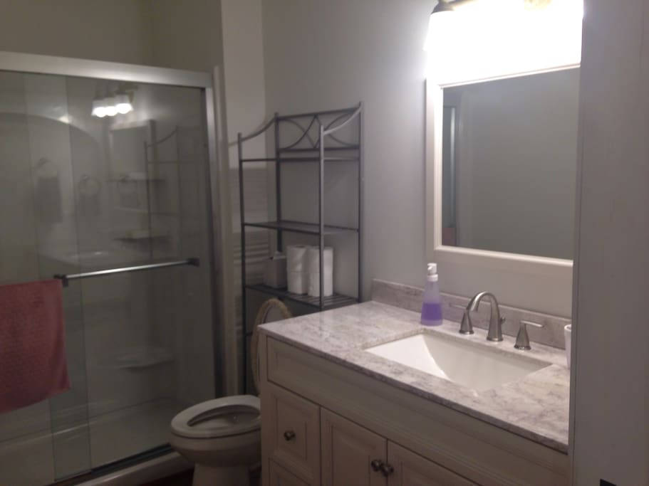 Nice, new bathroom with shower, no tub, towels and plenty of space for your things.